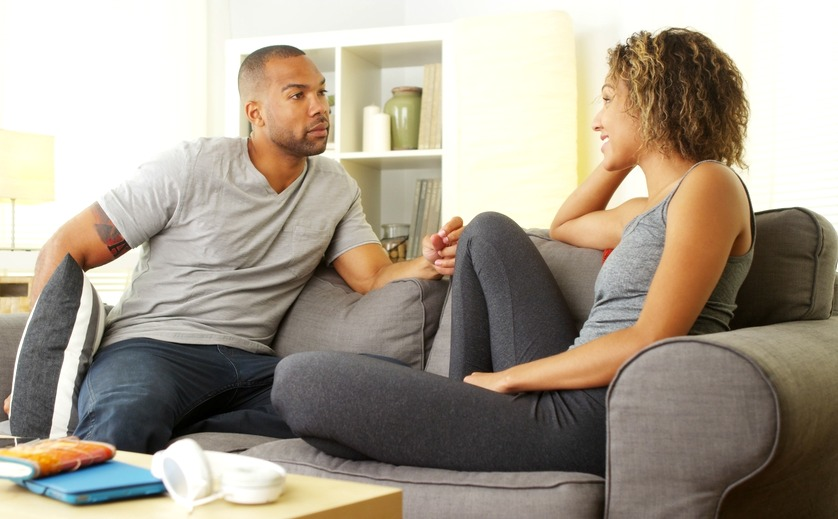 Two people sitting on a couch together looking happy and ready for couples counseling near westfield, nj. Online therapy in New Jersey can help relationships that need marriage counseling from a licensed online therapist in New Jersey.