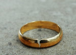 Cracked gold wedding ring. Divorce or infidelity can be discussed in marriage counseling or couples therapy in Westfield, NJ or through Online therapy in new Jersey with Mountainside Counseling Center.