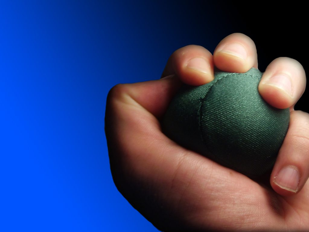 Hand holding a ball for coping with stress and stress management. Stress counseling in mountainside, NJ 07092 & and stress management in westfield, nj 07090. You can get online counseling for stress management in New Jersey here!