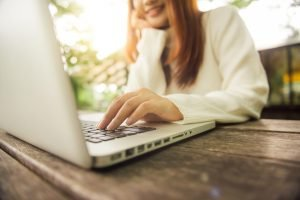 Cropped image of young woman using laptop during COVID 19 at home for online counseling in New Jersey with a licensed online therapist in New Jersey for telehealth.