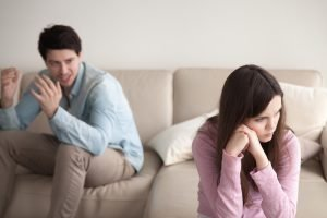Unhappy couple quarrelling, sitting apart indoors. Dealing with love after addiction and alcoholism with counseling for couples in recovery in New Jersey at Mountainside Counseling Center 07092 & 07090