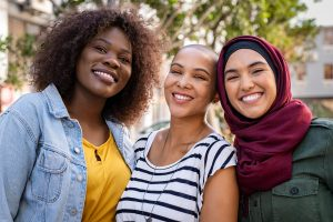 Portrait of young women of different cultures enjoying vacation together might need therapy for young adults in New Jersey for anxiety treatment, depression treatment or addiction counseling. Therapy for millennials in New Jersey can happen with Nicole at Mountainside Counseling or in online therapy in New Jersey 07092 & 07090