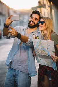 Smiling couple traveling and having fun in the city. Therapy for couples in recovery after addiction and alcoholism with counseling for couples in recovery in New Jersey. family addiction counseling in mountainside, nj at Mountainside Counseling Center 07092 & 07090