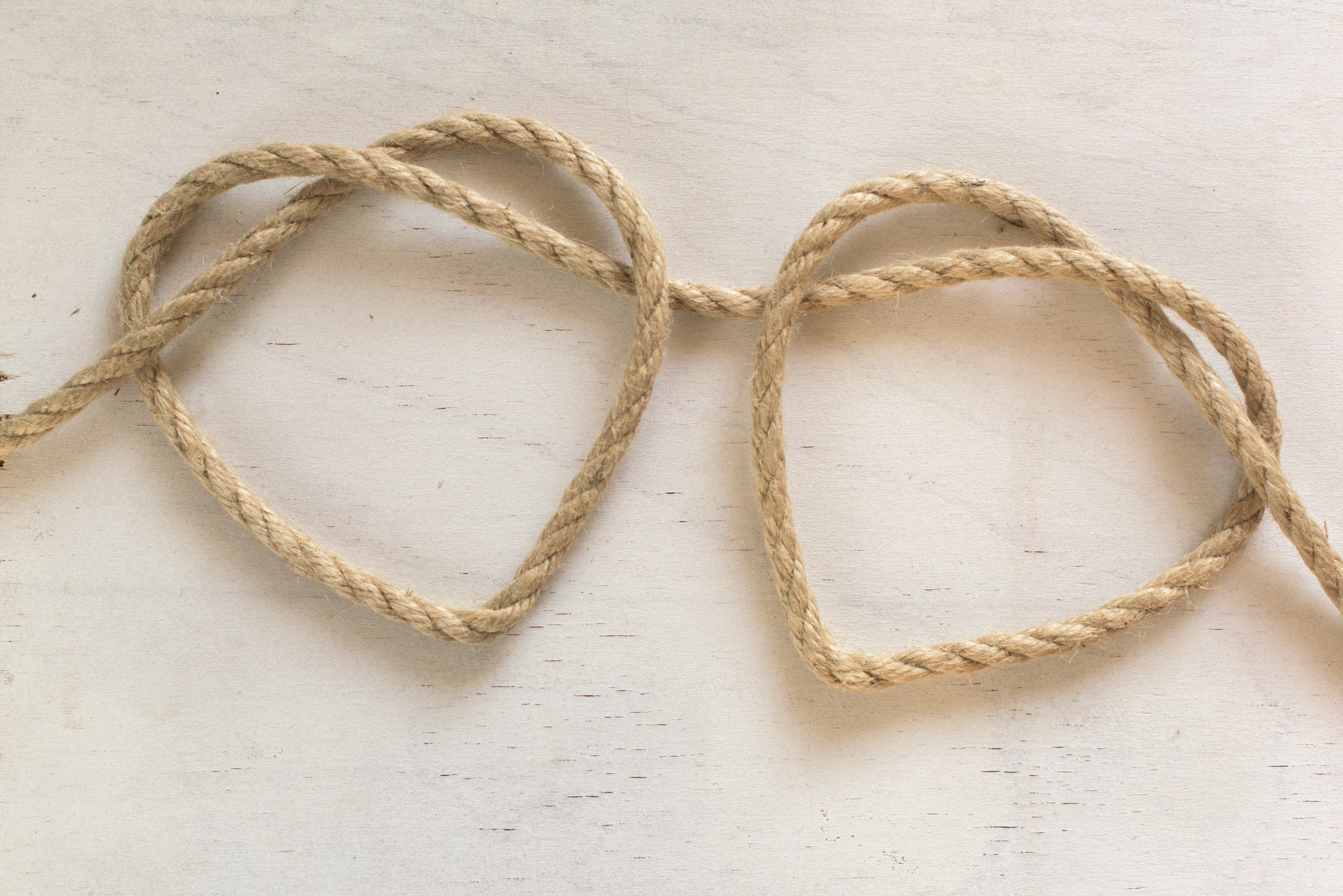Two heart ropes connected to a knot on white wood for marriage counseling in Mountainside, NJ. Finding the best marriage counseling in New Jersey doesn't have to be hard. Read from LMFT marriage counselor Nicole here! You can get online therapy in New Jersey 07092