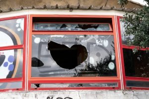 Building with Broken window and graffiti. Read on about the worst advice for couples in New Jersey from discernment counseling and marriage counselor from Mountainside, NJ. You can get help with online therapy in New Jersey here.