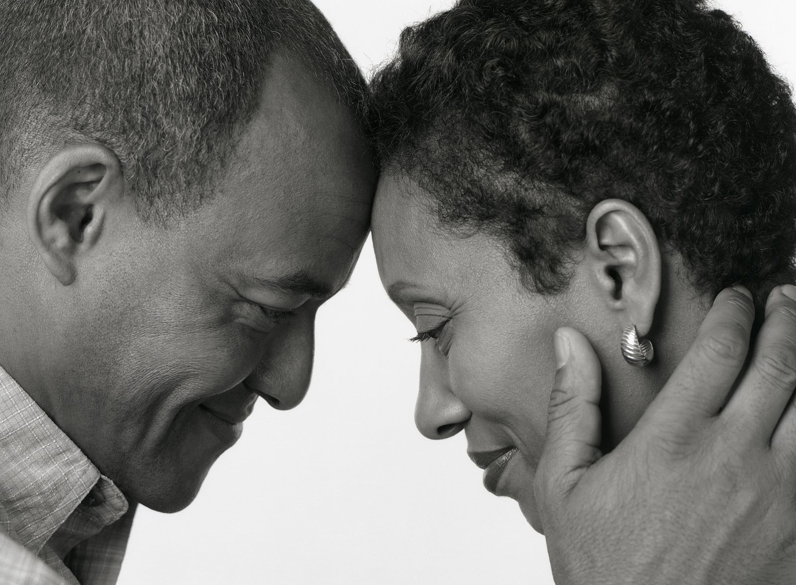 Black and White Portrait of African American Husband Wife on white background. You can get therapy for couples dealing with addiction in New Jersey here with a NJ addiction therapist for couples therapy and marriage counseling in online therapy in New Jersey. At Mountainside Counseling Center, you can get family addiction counseling in Mountainside, NJ near Westfield, NJ here.